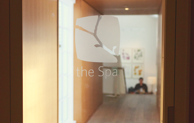 The Spa written on glass door