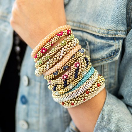 Beaded bracelets stacked on wrist