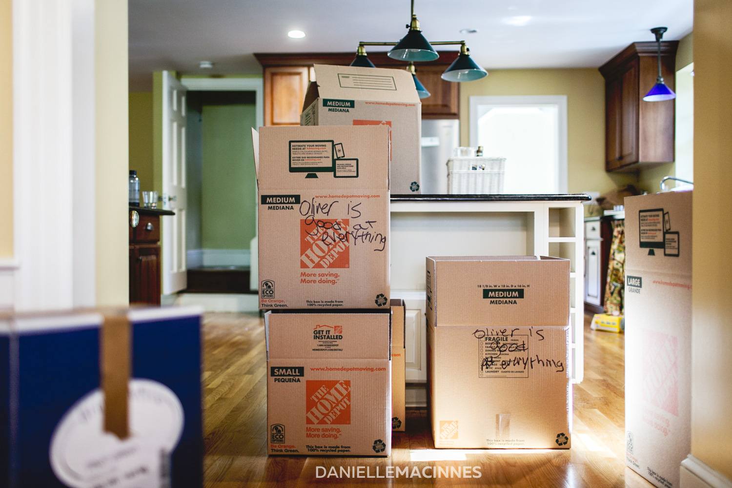 moving boxes stacked in kitchen