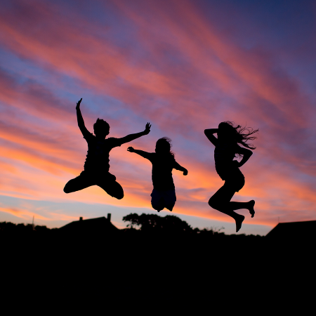 silhouette three kids jumping with pink and blue sky
