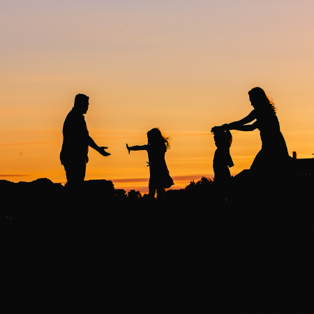 Family at sunset silhouette