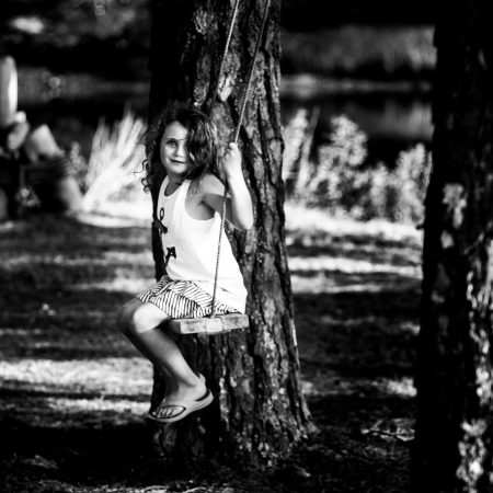 girl on swing black and white
