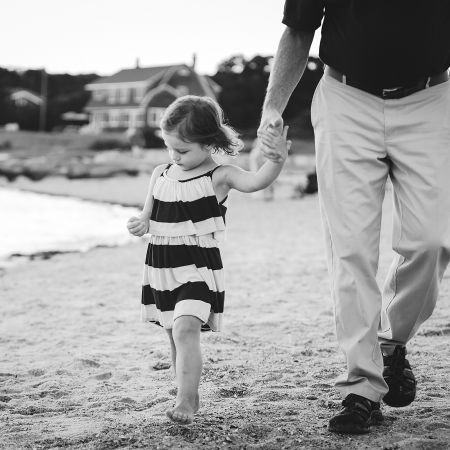little girl holding grandfather's hand