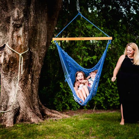 mom with two kids in blue rope swing