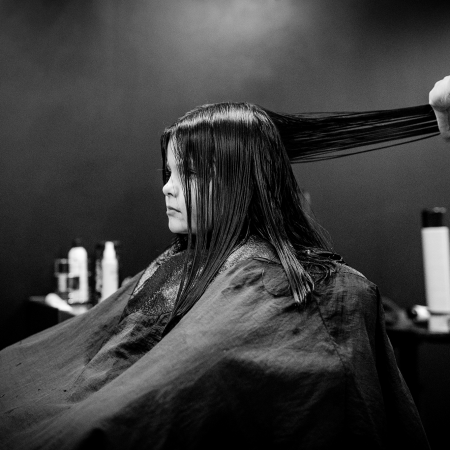 little girl getting haircut