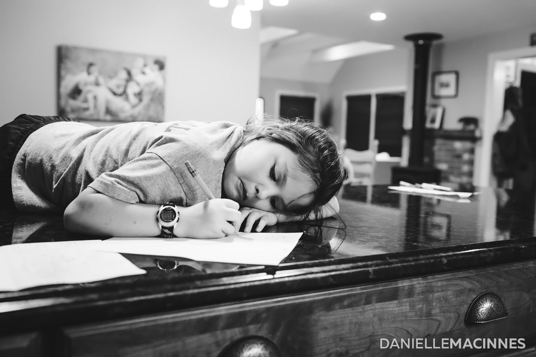 girl on counter writing