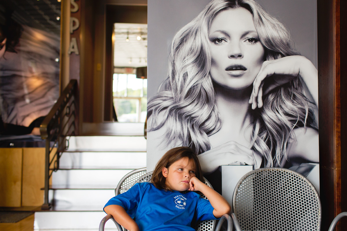 little girl sitting at hair salon