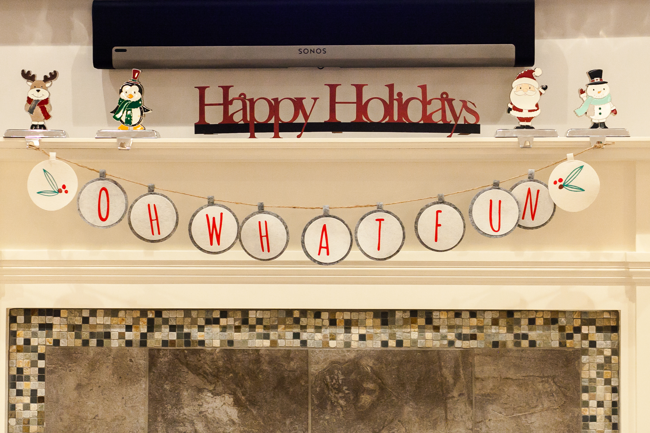 mantle decorated with Happy Holidays