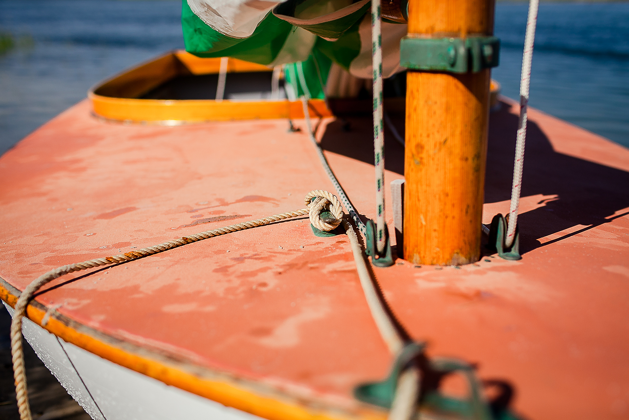 close up of boat cleat with rope tied around
