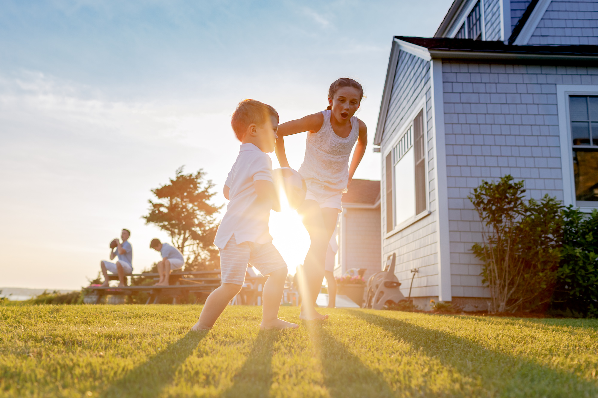 little boy running with girl sun burst