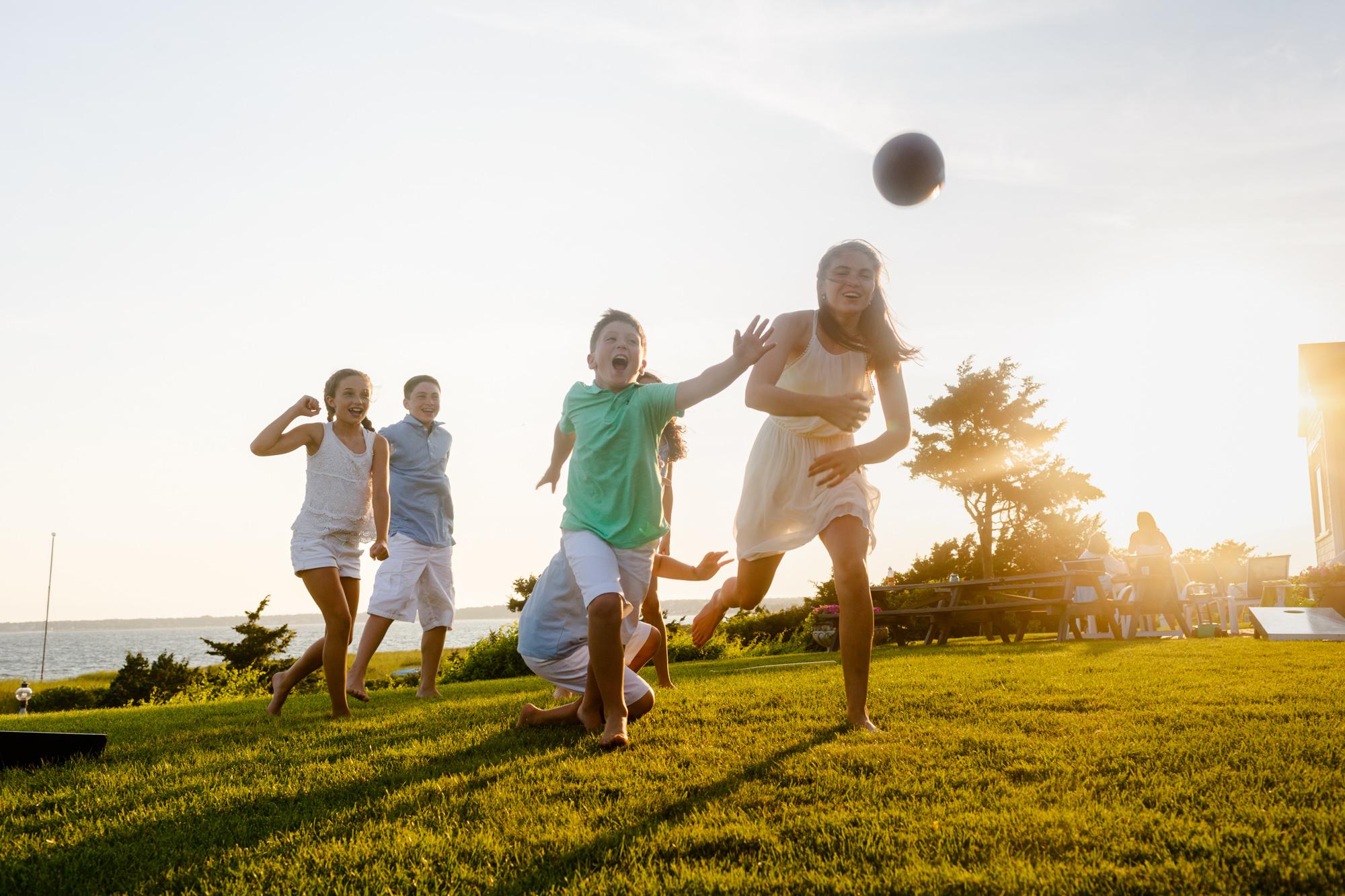 kids reaching for football