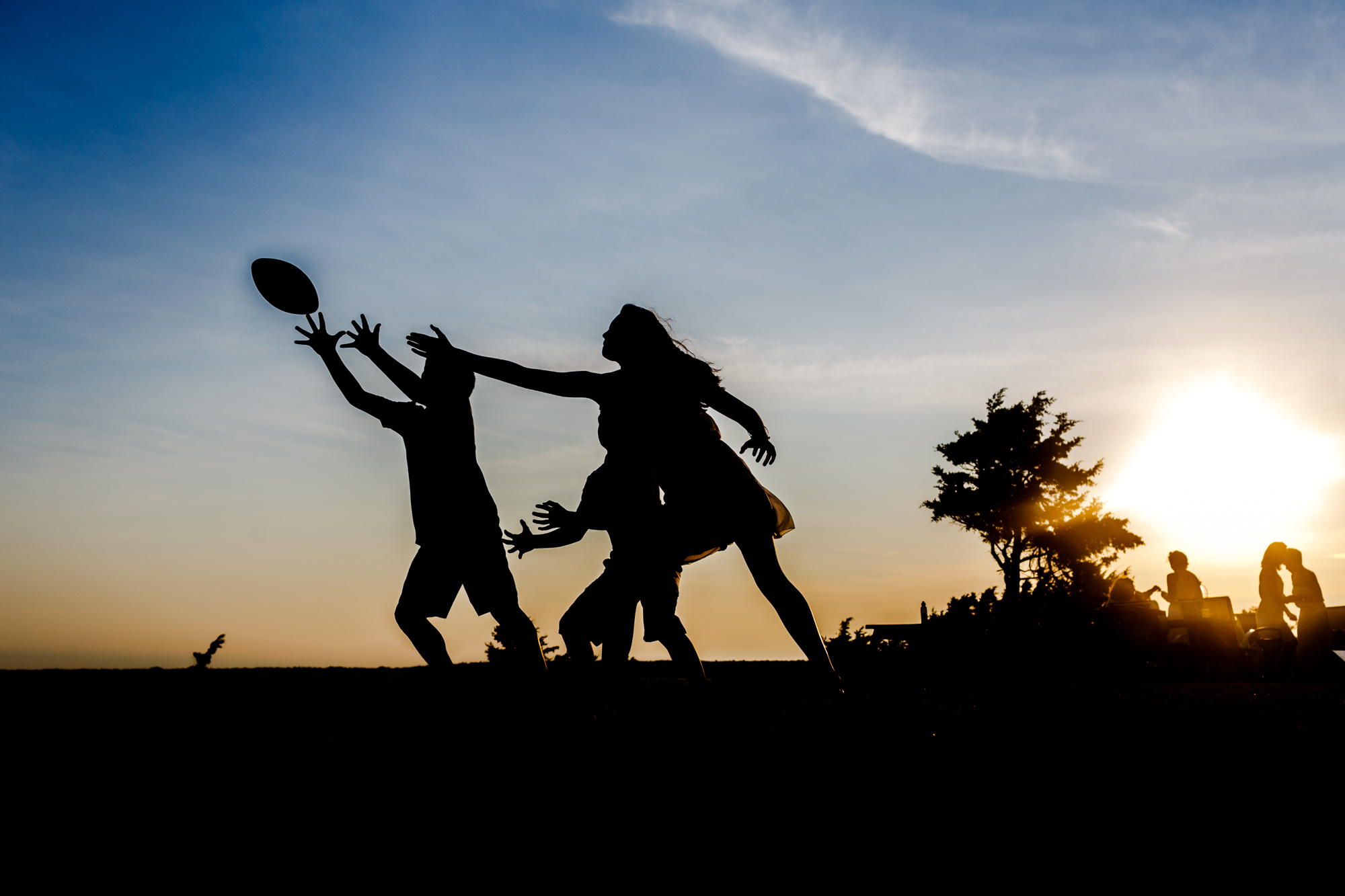 silhouette of kids reaching for football