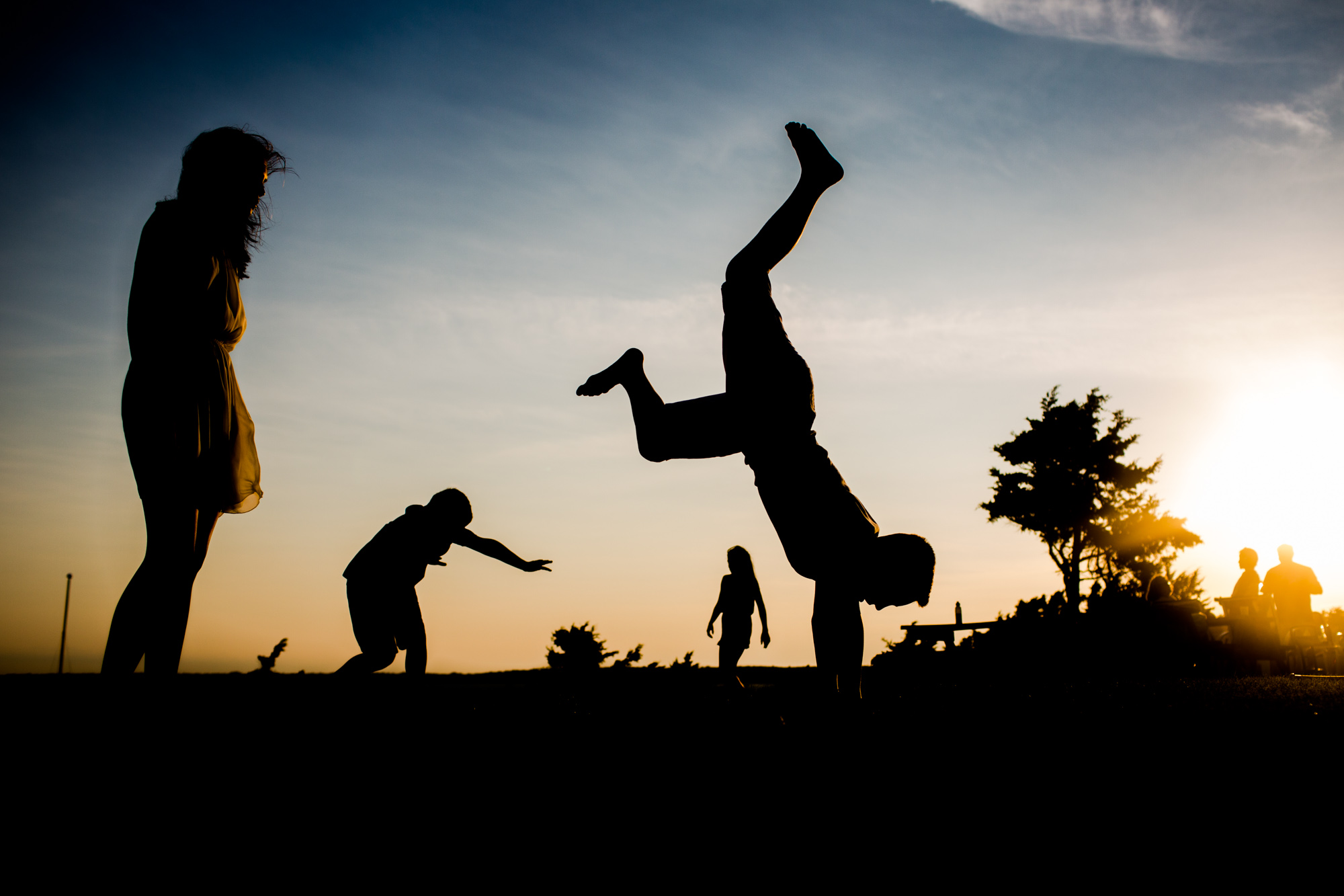 silhouette of boy flipping