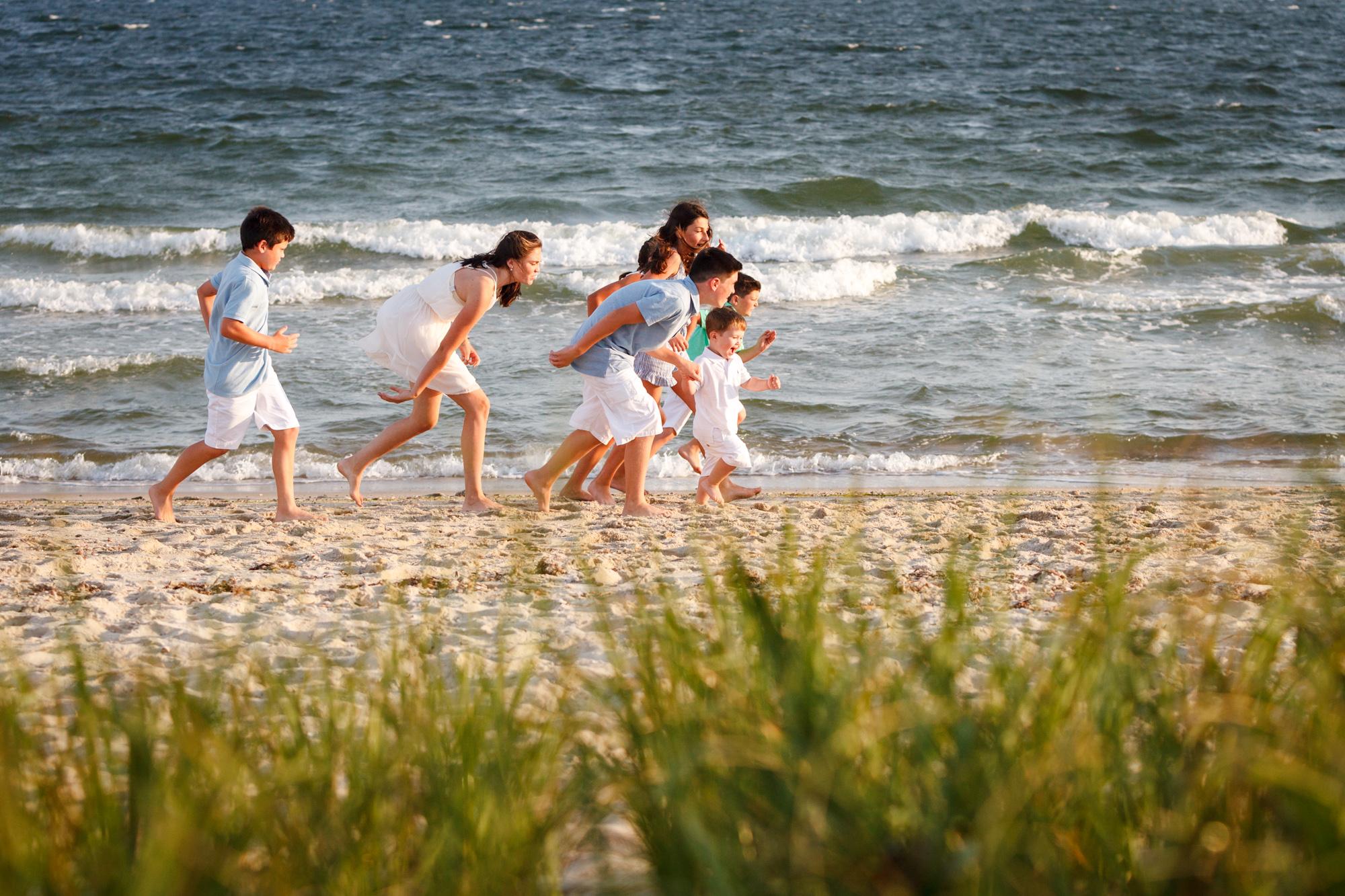kids running on beach at photoshoot