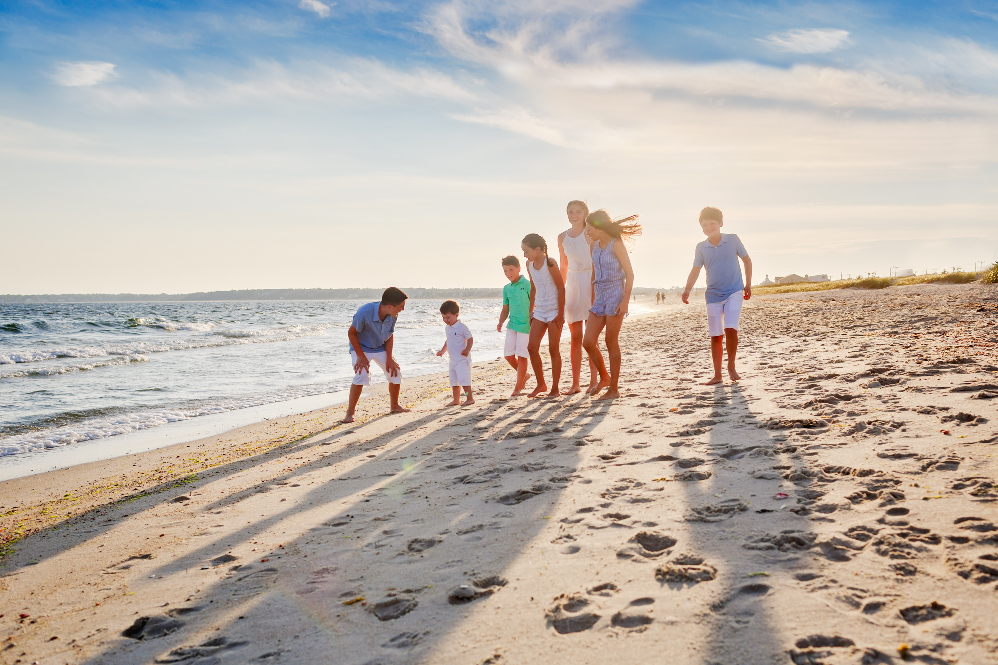 cousins on beach at golden hour