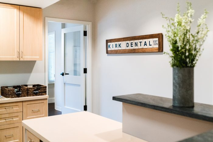 interior of office with lettered sign reading Kirk Dental