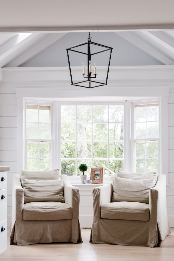 two oversized chairs in a white clean space