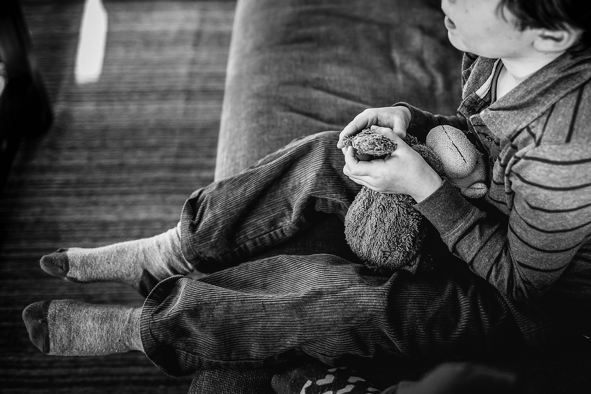 little boy's hands holding stuffed animal monkey