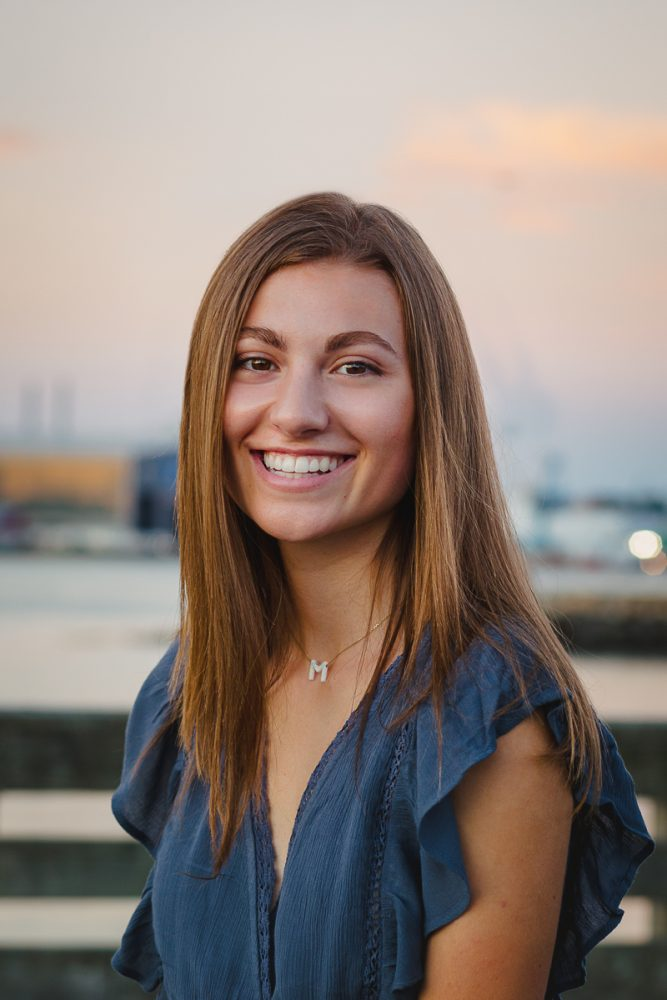 high school senior portrait girl with brown hair smiling